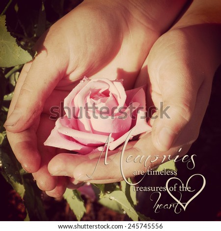 instagram of dirty garden hands holding rose with quote - stock photo