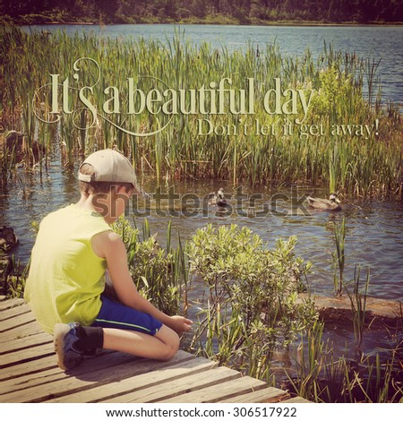 instagram of young boy feeding ducks  at summertime with quote - stock photo