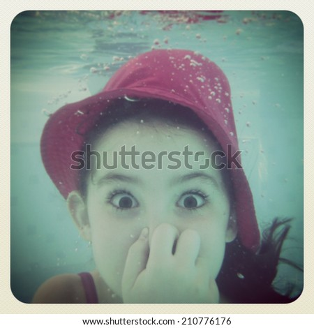 instagram of young girl having fun under water - stock photo