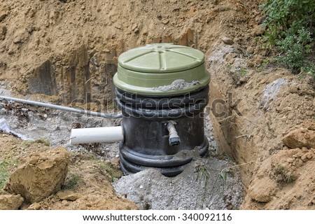 Installation Of A Grinder Pump Holding Tank - stock photo