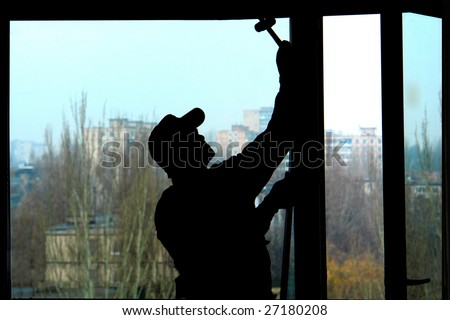 Installation of a window on a background of the house - stock photo