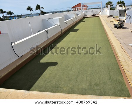 Installation of an artificial turf bocce ball court on a roof top terrace. - stock photo
