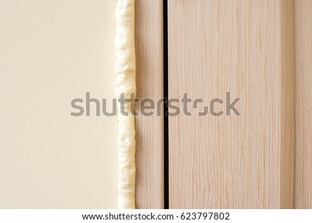 Installation of doors using polyurethane foam mounting. Cylinder Foam . polyurethane foam. Installation doors & Installation Doors Using Polyurethane Foam Mounting Stock Photo ...