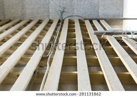 Installation of floor lags and cables - stock photo