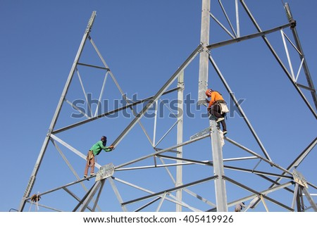 Installation of high voltage transmission towers.