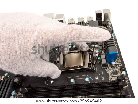 Installation of modern processor in CPU socket on the motherboard - stock photo
