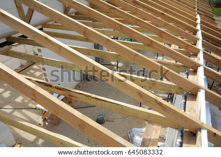 Installation wooden beams construction roof truss stock for Roof trusses installation