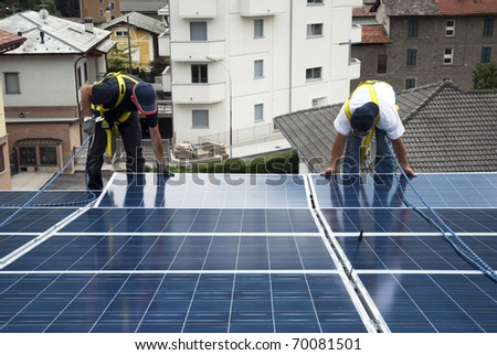 Installing solar panels - stock photo