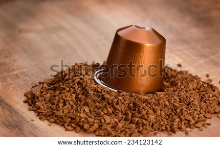 instant coffee granules and capsule on a wooden tray - stock photo