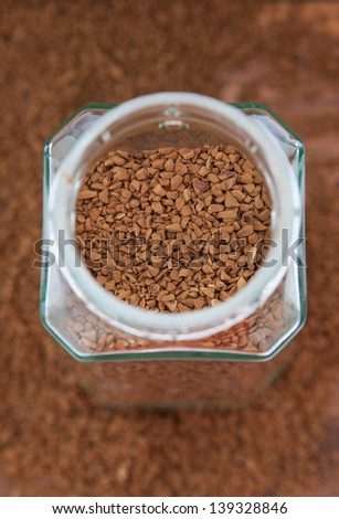 Instant coffee granules in glass bank-fragrant mixture  - stock photo