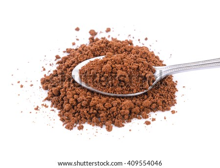 instant coffee in the spoon on white background - stock photo