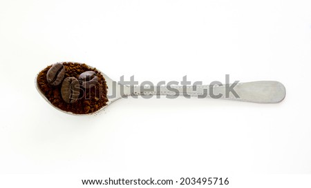 Instant coffee with roast coffee bean in the spoon - stock photo