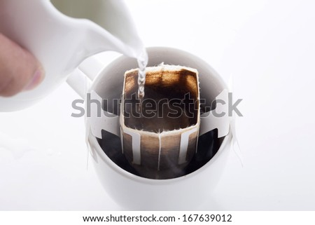 Instant freshly brewed cup of coffee,Drip bag fresh coffee - stock photo