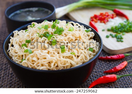 Instant noodles and soup to eat sliced onions and peppers and put the pork into. - stock photo