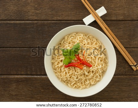 Instant noodles in bowls on wood table. top view - stock photo