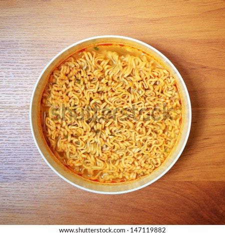 Instant noodles on wood baord - stock photo