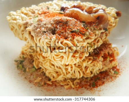 instant noodles, selective focus at noodle in middle of frame, shallow depth of filed,natual light. - stock photo