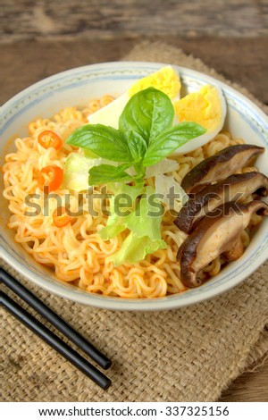 Instant noodles soup with mushroom, basil, chili and hard boiled egg