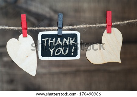 "Instant photo and paper heart hanging on the clothesline with words ""Thank You"". On old wood background. - stock photo"