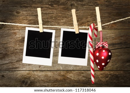 Instant photo frames on the wooden texture with christmas decoration - stock photo