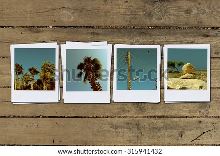 instant photo. Polaroid photo on table - stock photo