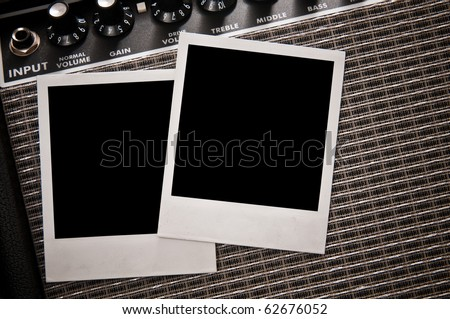 Instant photo prints on guitar amplifier - stock photo