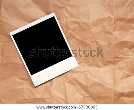 instant photograph on a wrinkled paper brown bag - stock photo