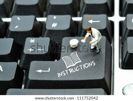 Instructions written on enter return key of keyboard - stock photo