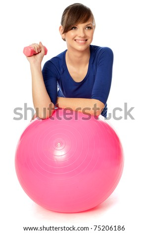 instructor showing exercises using ball and dumbbells at gym to people - stock photo
