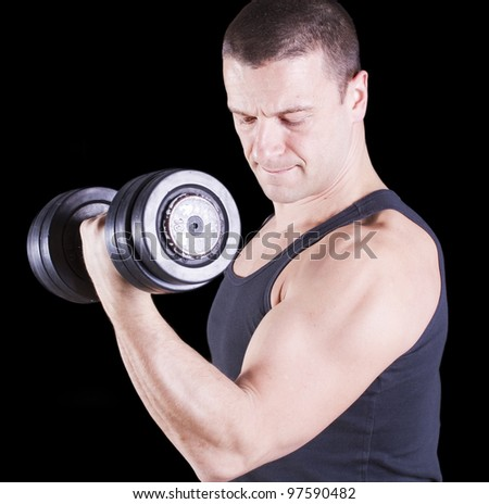 Instructor weightlifting in the gym - stock photo
