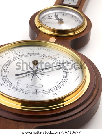 Instrument cluster with barometer and clock - stock photo