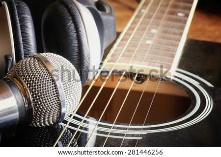instrument guitar headphones and microphone - stock photo