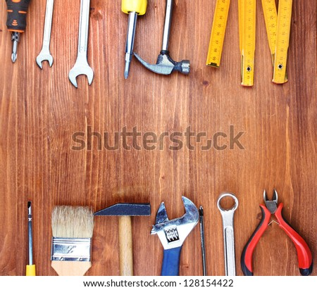 Instruments on wooden background - stock photo