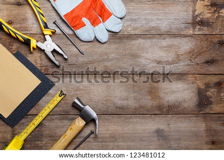 Instruments on wooden table - stock photo