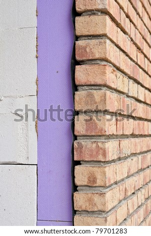 Insulated brick wall made of clinker - stock photo