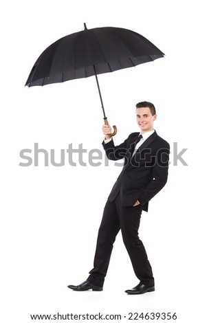 Insurance agent. Cheerful elegance man walking with an open umbrella. Full length studio shot isolated on white. - stock photo