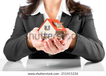 insurance and protection concept - realtor woman give a house  - stock photo