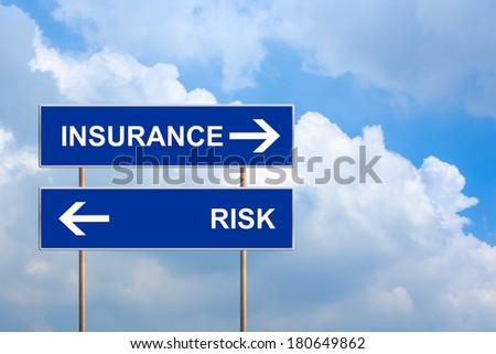 Insurance and risk on blue road sign with blue sky - stock photo