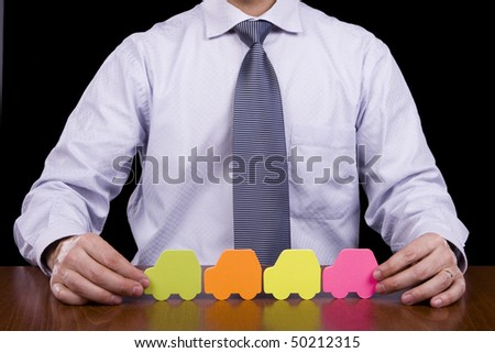 Insurance concept - Business man protecting many cars with his hands - stock photo