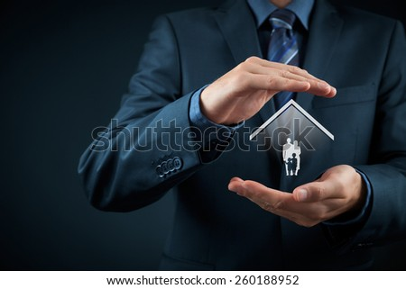 Insurance concept, family life and property insurance, family services and supporting families concepts. Businessman with protective gesture and silhouette representing young family and house. - stock photo