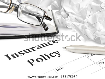 insurance policy form on desk in office showing risk concept. Life; Health, car, travel  - stock photo