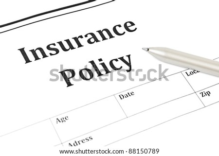 insurance policy form on desk in office showing risk concept. Life; Health, car, travel, for background - stock photo
