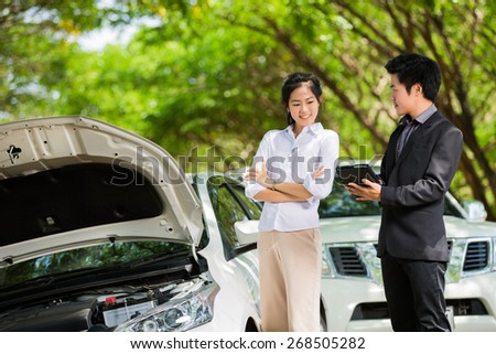 Insurance to discuss the accident and the car was a woman - stock photo