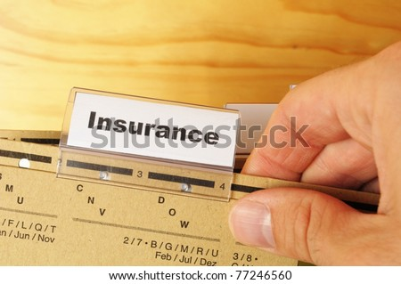 insurance word on business folder showing risk management concept - stock photo
