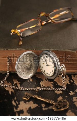 intage pocket watch old book and Brass Key glasses