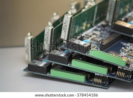 Integrated Circuits piled on a table. - stock photo
