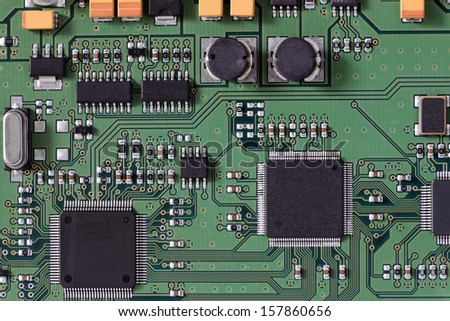 Integrated electronic circuit board schematic with conductors on a computer microchip or processor for connecting and communicating data - stock photo