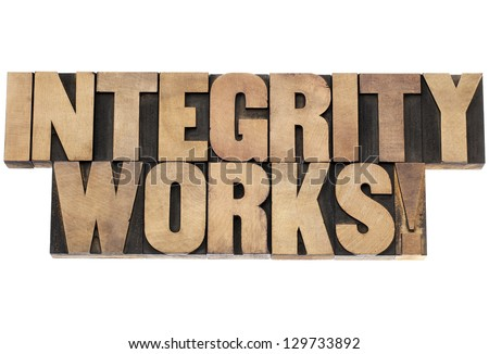 integrity works - isolated text in vintage letterpress wood type printing blocks - stock photo