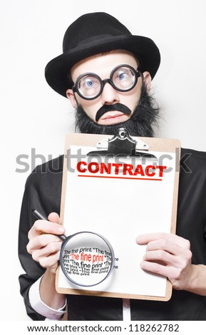 Intellectual Property Lawyer Warning About Reading The Fine Print On A Contact Disclaimer Before Signing On The Dotted Line - stock photo