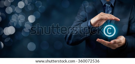 Intellectual property protection law and rights, copyright and patents concept. Protect business ideas and headhunter concepts. Wide banner composition with bokeh in background. - stock photo
